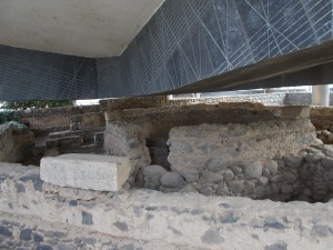 The ruins of Peter's house at Capernaum which has a modern church hovering above it.